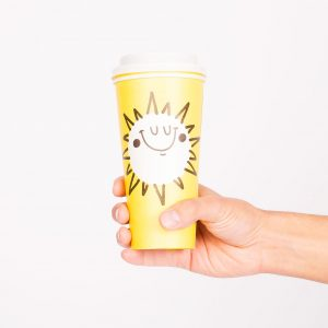 reusable coffee cup with yellow sun design