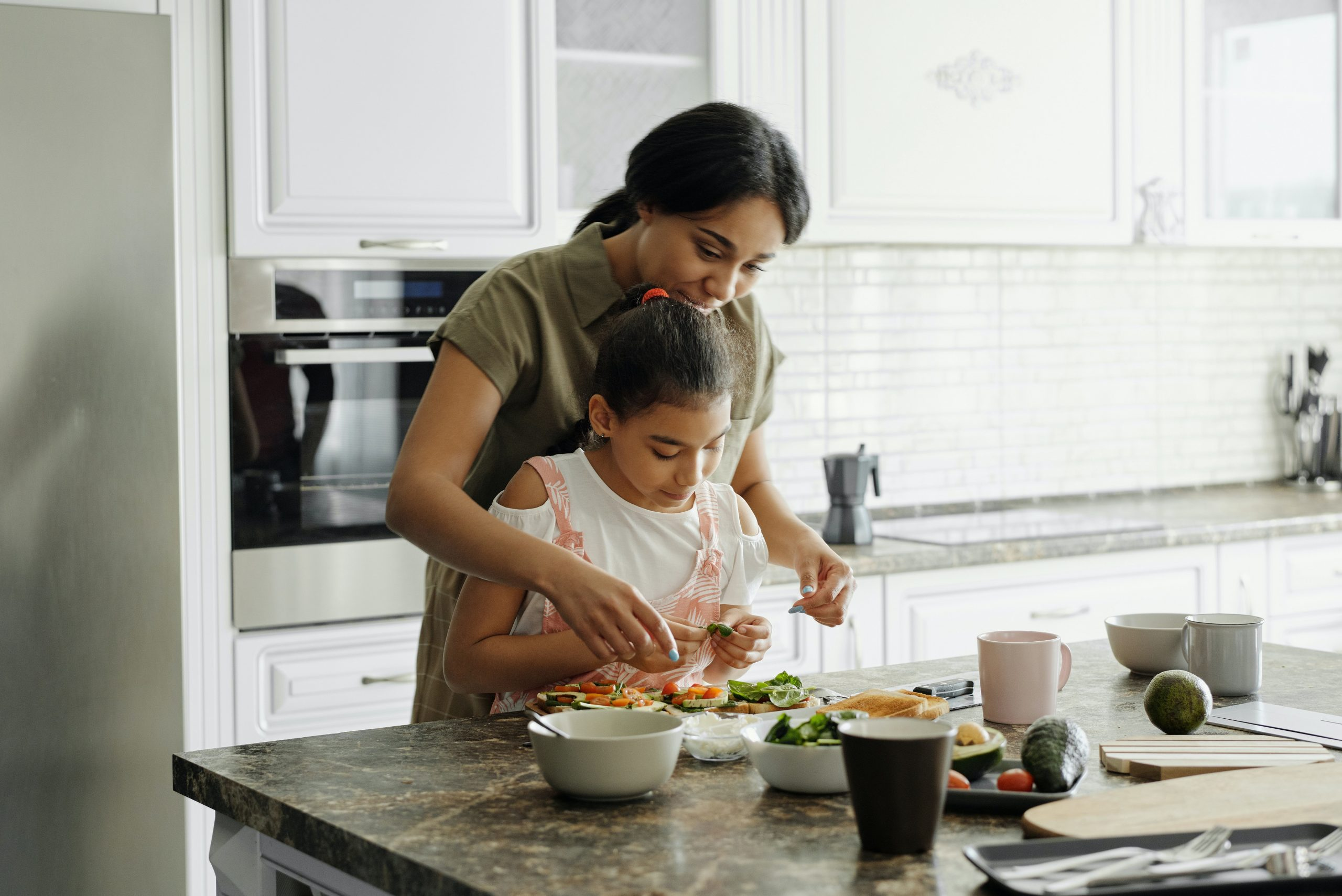 Photo of mother and child preparing food